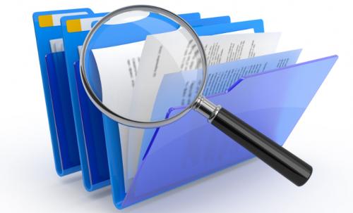 documentos y lupa